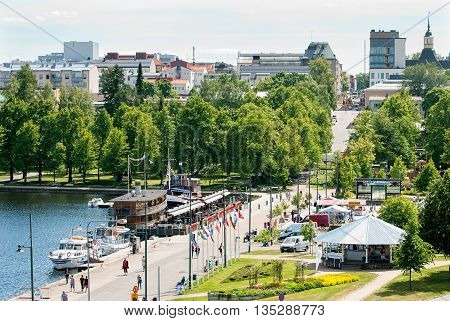 LAPPEENRANTA, FINLAND - JUNE 15, 2016: Top view of the city embankment with Harbor Market (Satamatori), restaurants on Saimaa Lake and part of the town with Saint Mary Church