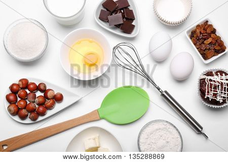 Cake ingredients on white table. Flat lay