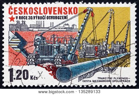 CZECHOSLOVAKIA - CIRCA 1975: a stamp printed in Czechoslovakia shows Construction of Friendship Pipeline Socialist Construction 30th Anniversary circa 1975