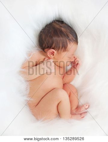 Newborn baby sleeping on white blanket. New life concept.