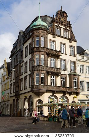 TRIER, GERMANY - SEPTEMBER 15, 2010: A beautiful house on the Market square in Trier city in Germany. Trier is the oldest city in Germany. Market square is situated in the center of the Trier's old town. The house was in the past a cathedral hotel.