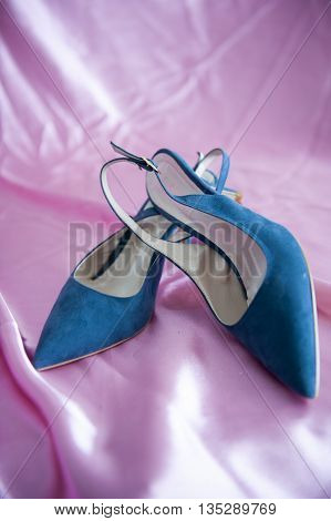 a elegant shoes neck and blue heels
