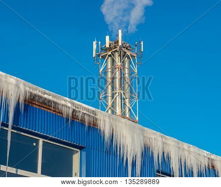 Large icicles hanging from the roof of the boiler house