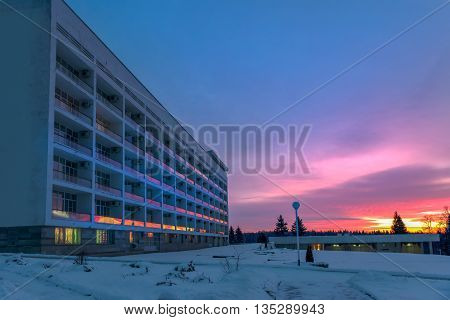 Sunrise reflected in the glass building balconies