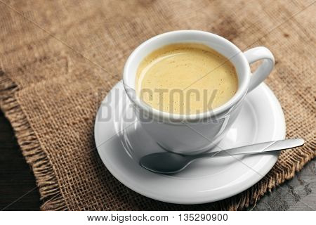 Cup of coffee on tablecloth