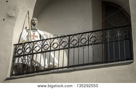 Knight - crusader soldier on balcony of castle