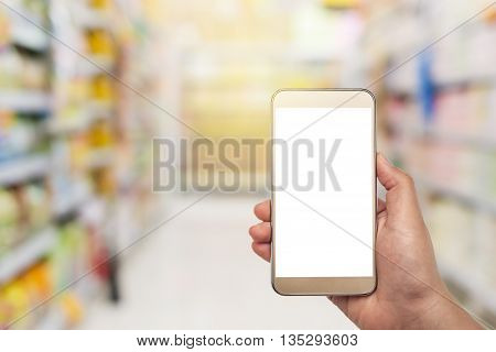 Hand with smartphone white screen on blurred in shopping mall background