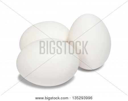 Three white raw eggs on white background