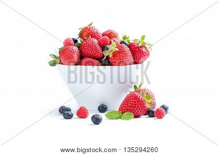 set of strawberries in the foreground on white background