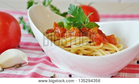 spaghetti sauce and tomatoes, a dish enjoyed by millions of people