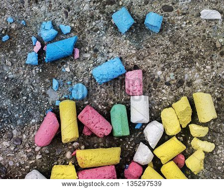 Scattered chalks on the ground waiting to be used.
