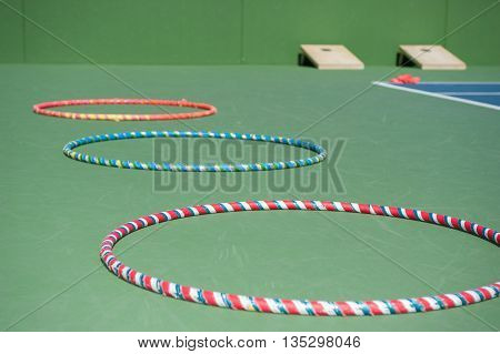 Hula hoops lying in a straight row.