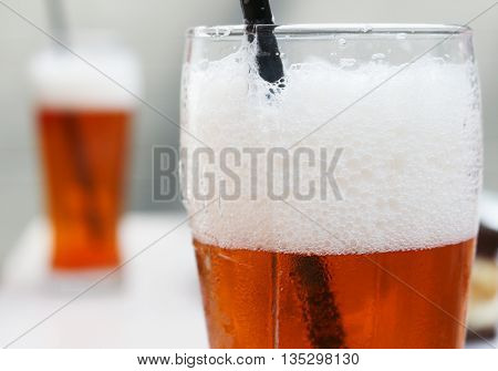 the glass of beer; shallow depth of field
