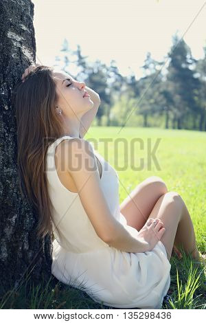 Portrait of a young beautiful girl on the spring meadow