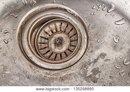 detail shot of a old dirty sink with scrubber inside.old sinkdrop in sink