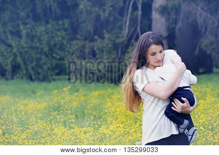 mother tenderly embracing her child in nature
