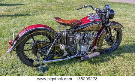 GROSSE POINTE SHORES MI/USA - JUNE 19 2016: A 1938 Indian Sport Scout motorcycle at the EyesOn Design car, show held at the Edsel and Eleanor Ford House, near Detroit, Michigan.