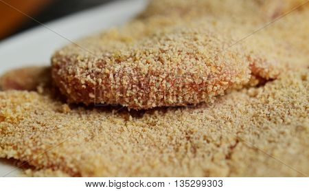 beef schnitzel with breadcrumbs and flour. hamburger