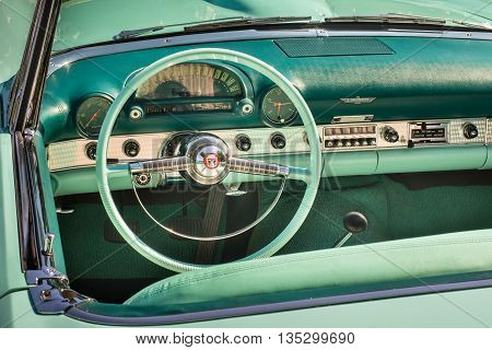 GROSSE POINTE SHORES MI/USA - JUNE 19 2016: A 1955 Ford Thunderbird dashboard at the EyesOn Design car show, held at the Edsel and Eleanor Ford House, near Detroit, Michigan.