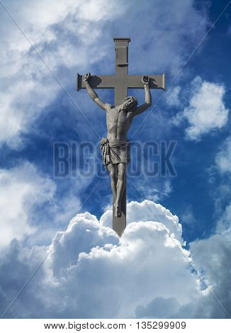 Jesus high in clouds nailed to a cross.
