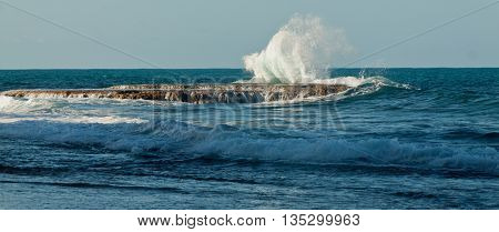 Waves of the Pacific Ocean crashing against the rocks at La Chocolatera near Salinas, Ecuador