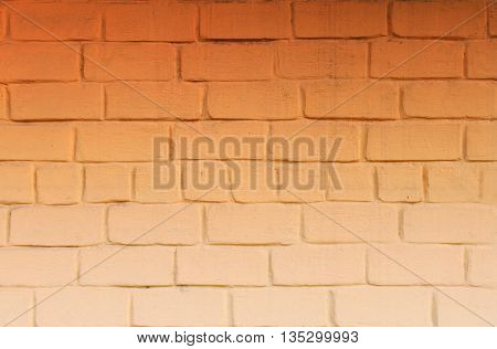 Orange Brick Wall with Light Changing from Light to Dark