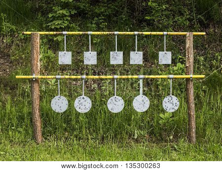 Ten metal targets for practicing a marksmanship skill.