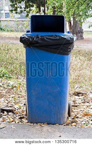 Close up old large blue wheel bin