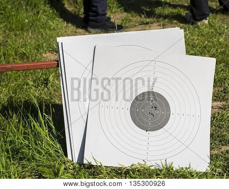 Used paper targets with some bullet holes.