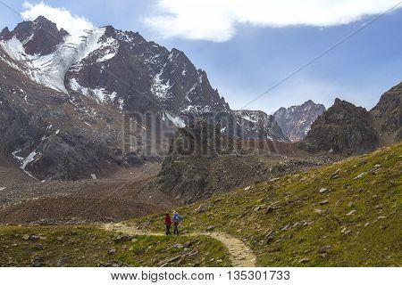 Couple hiking in the Ala Tau Mountains in Almaty, Kazakhstan