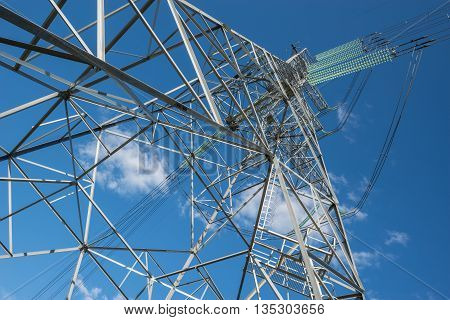 High-voltage tower on the blue sky background.