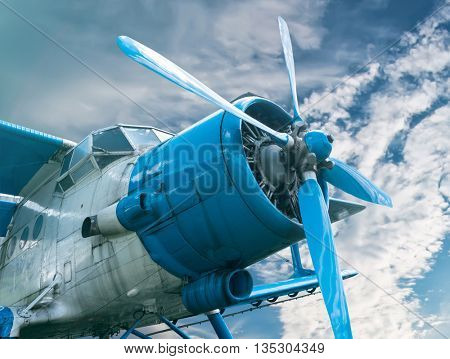 plane with propeller on beautiful bright sky background