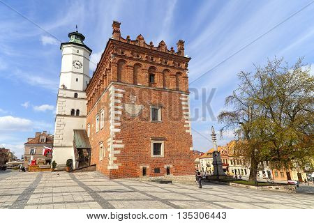 SANDOMIERZ, POLAND -  April 29,2016. View on market with Sandomierz Town Hall on sunny day.Sandomierz is known for its Old Town which is a major tourist attraction.
