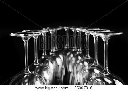 Empty wine glasses on black background, closeup