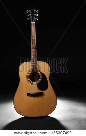 New acoustic guitar on dark background