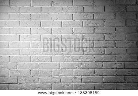 Grey brick wall background with shadow