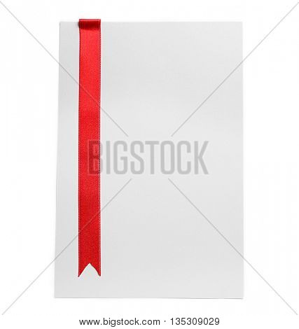 Red ribbon on light background