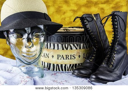 Paris France hat box black boots glass head wearing hat on vintage blue dress and gold background