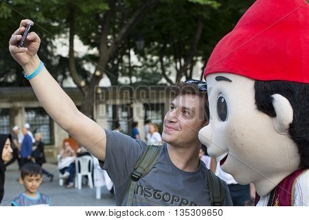 ISTANBUL, TURKEY - 6  JUNE , 2016:Celebrating the start of the holy month of Ramadan for Muslims in the Sultan Mahmed Square in Istanbul, 6  JUNE , 2016 Istanbul, Turkey