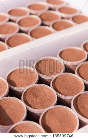 Pattern of planktonic shrimp paste in a plastic jars. Preparation for sale. Selective Focus.
