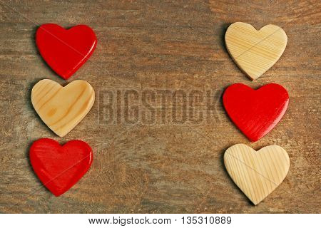 Wooden hearts on rustic wooden background