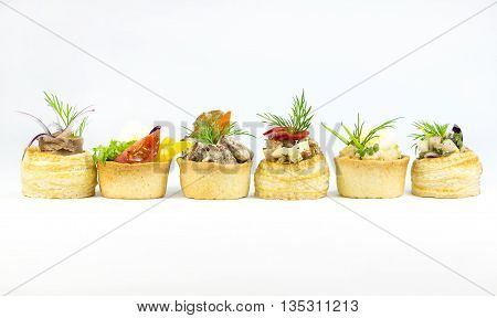 Mini Canape with meat and vegetables in plastic cups
