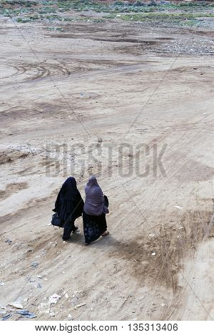 Women walking together muslim women in traditional clothes Egypt.