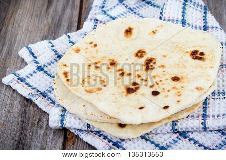 Homemade Naan Flatbread on a table tablecloth