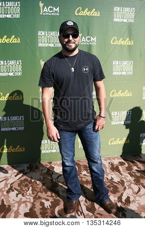 ARLINGTON, TX - APR 18: Tyler Farr attends the ACM & Cabela'??s Great Outdoor Archery Event during the 50th Academy Of Country Music Awards at the Texas Rangers Youth Ballpark on April 18, 2015.