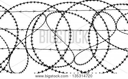 Silhouette of patterns in a barbed wire fence