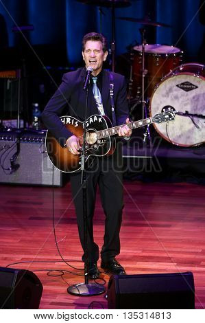 NASHVILLE, TN-SEP 1: Chris Isaak performs onstage during the 9th Annual ACM Honors at the Ryman Auditorium on September 1, 2015 in Nashville, Tennessee.