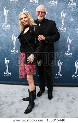 NASHVILLE, TN-SEP 1: Tim Dubois (R) and wife Pam Dubois attend the 9th Annual ACM Honors at the Ryman Auditorium on September 1, 2015 in Nashville, Tennessee.