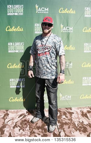 ARLINGTON, TX - APR 18: Recording artist Brantley Gilbert attends the ACM & Cabela'??s Great Outdoor Archery Event at the Texas Rangers Youth Ballpark on April 18, 2015.