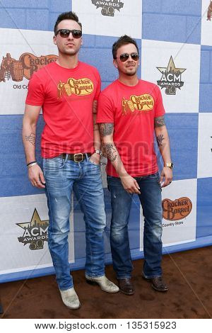 ARLINGTON, TX - APR 18: Eric Gunderson (L) & Stephen Barker Liles of Love and Theft attend the Cracker Barrel Checkers Challenge at Globe Life Park in Arlington on April 18, 2015 in Arlington, Texas.